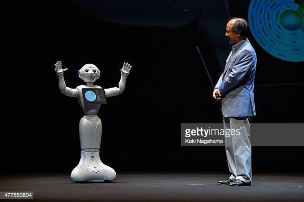 Pepper and Masayoshi Son, Chairman and Chief executive officer of SoftBank Corp talk during the news conference on June 18, 2015 in Chiba, Japan....