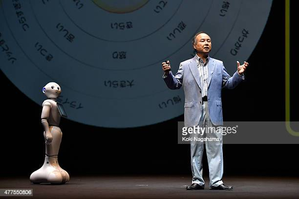 Pepper and Masayoshi Son Chairman and Chief executive officer of SoftBank Corp talk during the news conference on June 18 2015 in Chiba Japan...