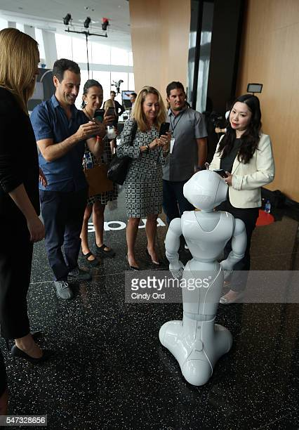 Pepper demonstrates using Masterpass to guests during the Mastercard Evolution of Commerce event at One World Observatory on July 14 2016 in New York...