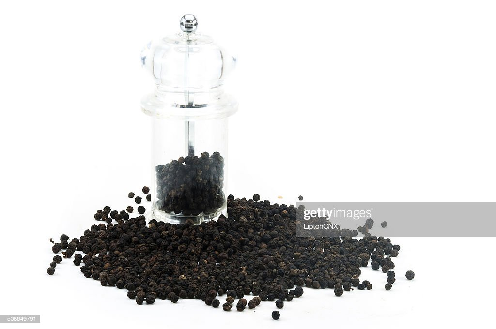 Pepper Grinder with black peppercorn : Stock Photo