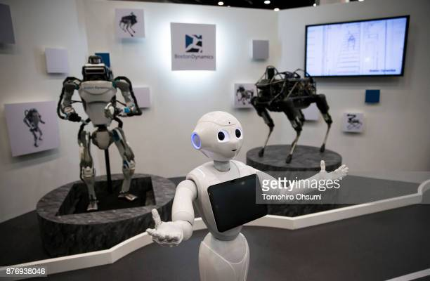 Pepper humanoid robot is demonstrated in front of Atlas left and Spot robots displayed during the SoftBank Robot World 2017 on November 21 2017 in...