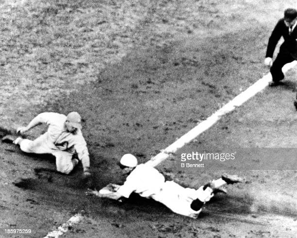 Pepper Martin of the St Louis Cardinals steals third base as Jimmy Dykes of the Philadelphia Athletics is late with the tag during Game 2 of the 1931...
