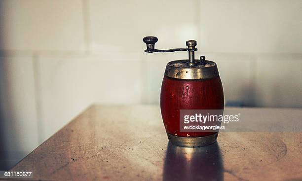 pepper mill on a table - pepper mill stock pictures, royalty-free photos & images