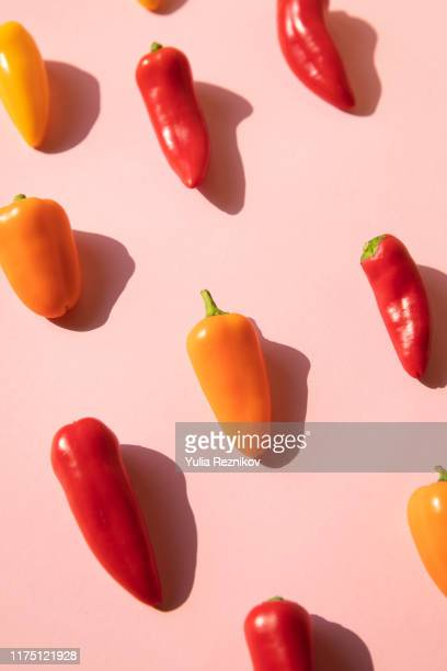 pepper on the pink background - pepper vegetable stock pictures, royalty-free photos & images