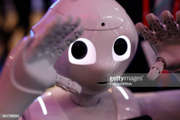 A Pepper robot by SoftBank Robotics is pictured at the Mobile World Congress the world's biggest mobile fair on February 27 2018 in Barcelona The...