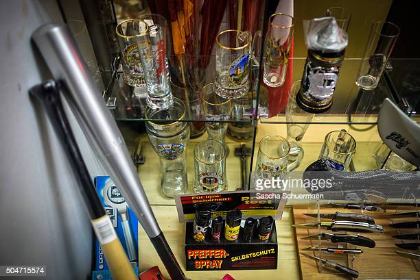 Pepper spray baseball bats knives and beer glasses are on display near of Hauptbahnhof main railway station at a store window where on New Year's Eve...