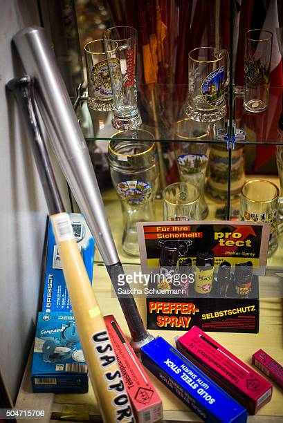 Pepper spray baseball bats knives and beer glasses are shown on display near of Hauptbahnhof main railway station at a store window where on New...