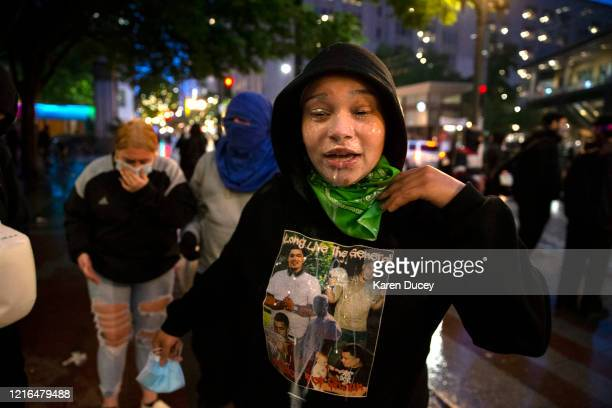 Pepper spray drips from the face of protester during a riot on May 30, 2020 in Seattle, Washington. A peaceful rally was held earlier in the day...