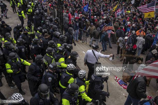 Pepper spray is used against demonstrators as they breach the U.S. Capital building grounds in Washington, DC, U.S., on Wednesday, Jan. 6, 2021. The...