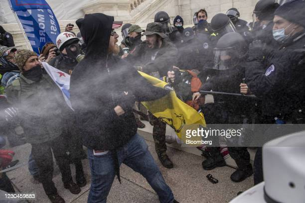 Pepper spray is used as demonstrators battle with U.S. Capitol police officers while breaching the Capitol building grounds in Washington, DC, U.S.,...