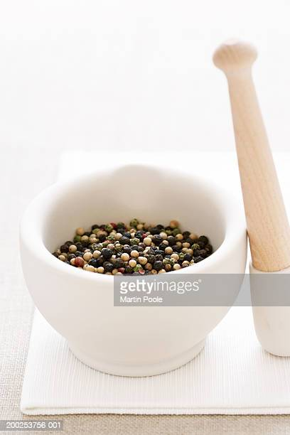 Peppercorns in mortar and pestle, close-up