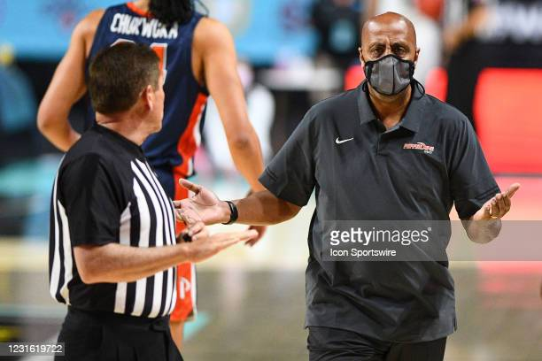 Pepperdine head coach Lorenzo Romar reacts to a call during the semifinal game of the men's West Coast Conference basketball tournament between the...