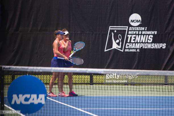 Pepperdine University tennis player Dzina Milovanovic talks with doubles partner Adrijana Lekaj in the quarterfinal round of the NCAA Division I...