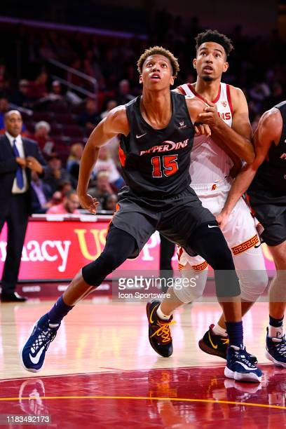 Pepperdine Waves forward Kessler Edwards boxes out USC Trojans forward Isaiah Mobley for a rebound during a college basketball game between the...