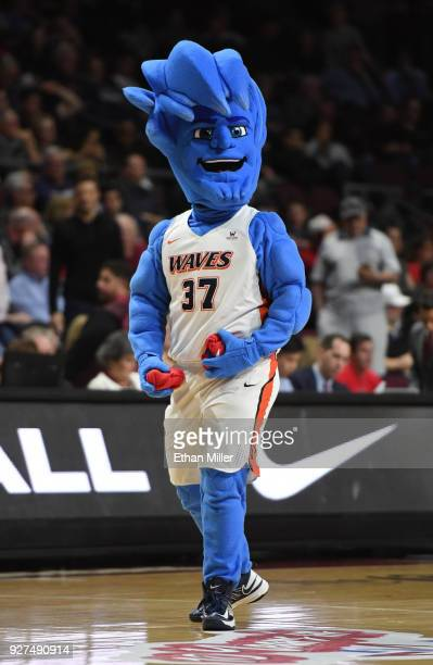 Pepperdine Waves mascot Willie the Wave throws T-shirts into the crowd during the team's quarterfinal game of the West Coast Conference basketball...