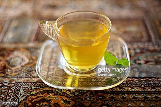 Peppermint green tea on exotic rug