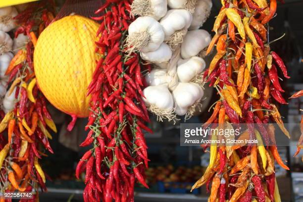 Pepperoncini and garlics hanging. Campania region, Italy.
