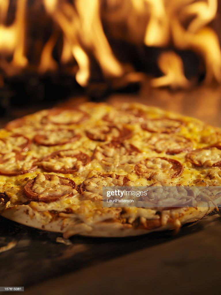Pepperoni Pizza in a Wood Burning oven : Stock Photo