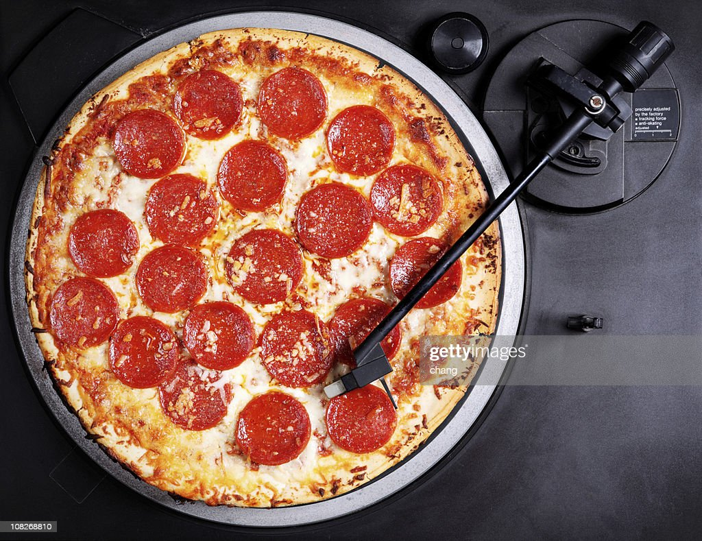 Pepperoni Pizza on Record Player Turntable : Stock Photo