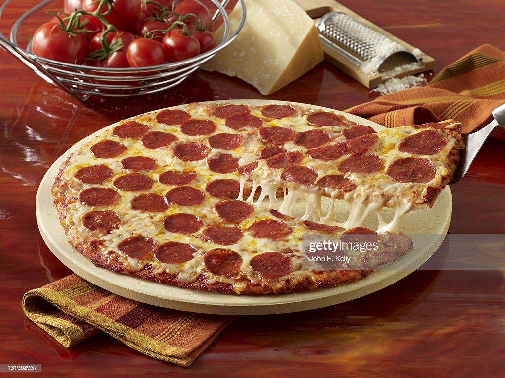 Pepperoni Pizza Pull : Stock Photo