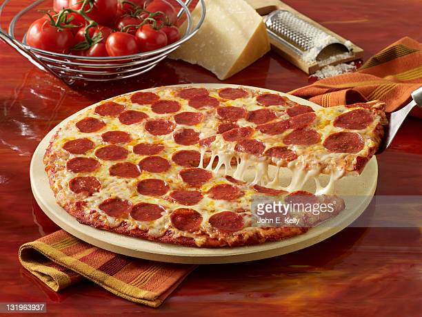 pepperoni pizza pull - pepperoni pizza stock photos and pictures