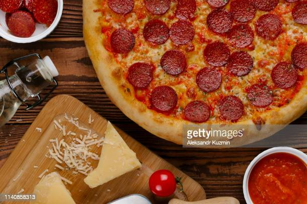 pepperoni pizza with ingredients - pepperoni pizza stock photos and pictures