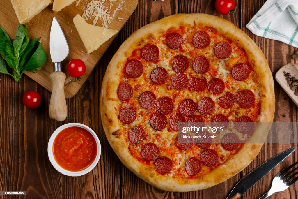 Pepperoni pizza with ingredients : Stock Photo