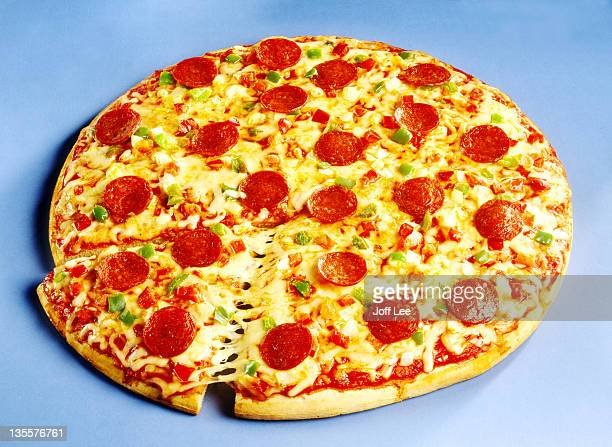 pepperoni pizza with slice cut - pepperoni pizza stock photos and pictures