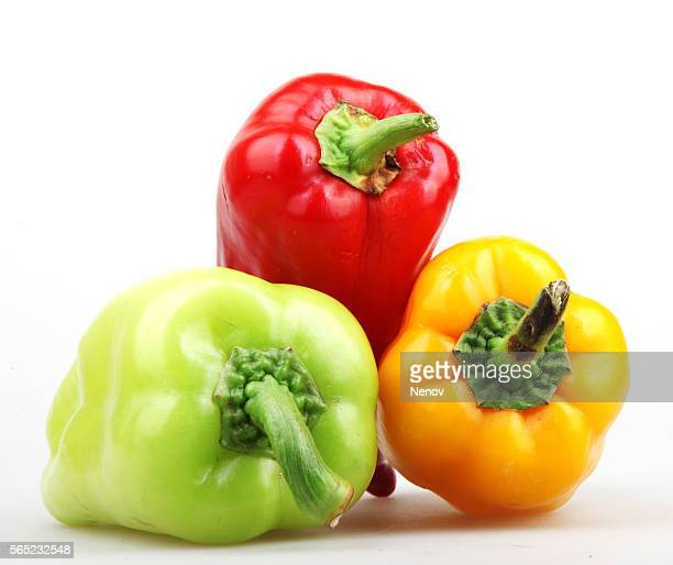 peppers isolated on white background - paprika stock pictures, royalty-free photos & images