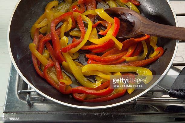 Peppers sauteed in the pan Eggs with cherry tomatoes and peppers step 2