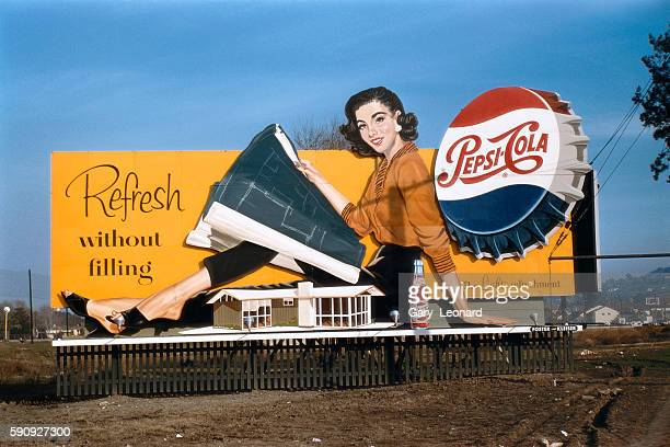 Pepsi Billboard with a Pepsi cap and woman beside a model home looking at a blueprint in 1957 in Los Angeles California 1950's Billboard with pepsi...