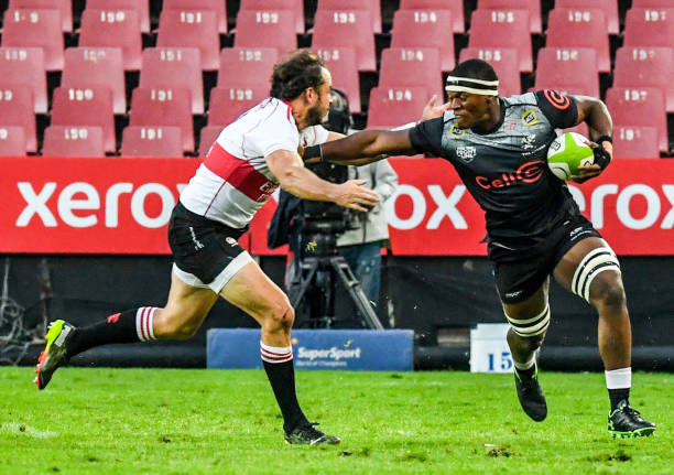 JOHANNESBURG, SOUTH AFRICA - MARCH 20: Pepsi Buthelezi of the Sharks with the ball challenged by Odendaal of the Lions during the SA Rugby Preparation Series match between Emirates Lions and Cell C Sharks at Emirates Airline Park on March 20, 2021 in Johannesburg, South Africa. (Photo by Sydney Seshibedi/Gallo Images/Getty Images)