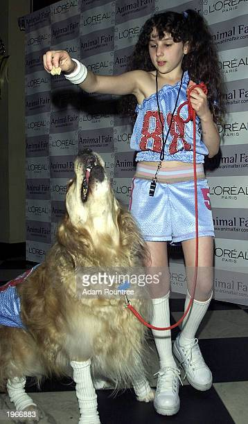 Pepsi girl Hallie Kate Eisenberg and 'Tara' arrive at the fourth annual Paws for Style fundraiser hosted by Animal Fair Magazine May 1 2003 in New...