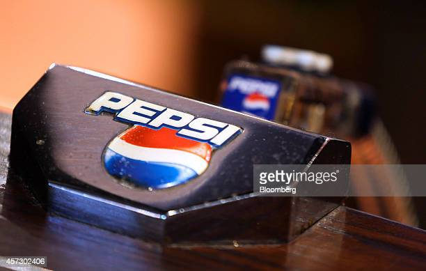 A Pepsi logo sits on a PepsiCo Inc soft drinks pump on the bar inside The Yew Tree pub operated by Chef and Brewer a unit of Spirit Pub Co in Great...