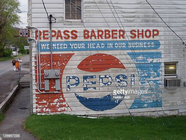 Pepsi sign advertising the Repass Barber Shop, North Tazewell, Virginia. A clever slogan and a soft drink logo packs 'em in!
