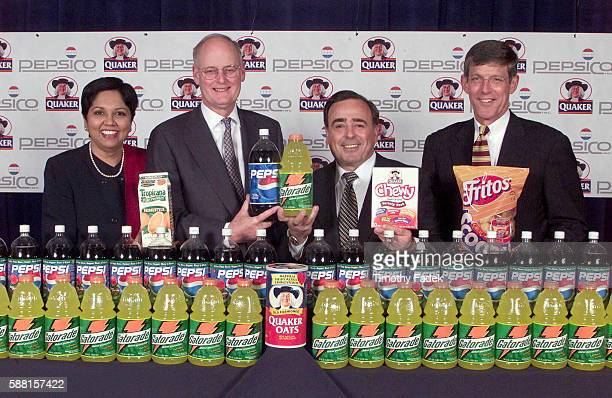 PepsiCo Inc. Has agreed to acquire the Quaker Oats Company. L-R: Pres. And CFO Indra Nooyi, Quaker Chairman and CEO Robert Morrison, Vice Chairman...