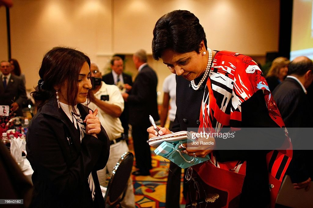 PepsiCo's chair and CEO, Indra Nooyi (R) signs an autograph for Almas Khan as she visits the Miami Dade College Miami Leadership Roundtable September 10, 2007 in Miami, Florida. Nooyi guides one of the world's largest convenient food and beverage companies that has one of the most recognizable brand names.