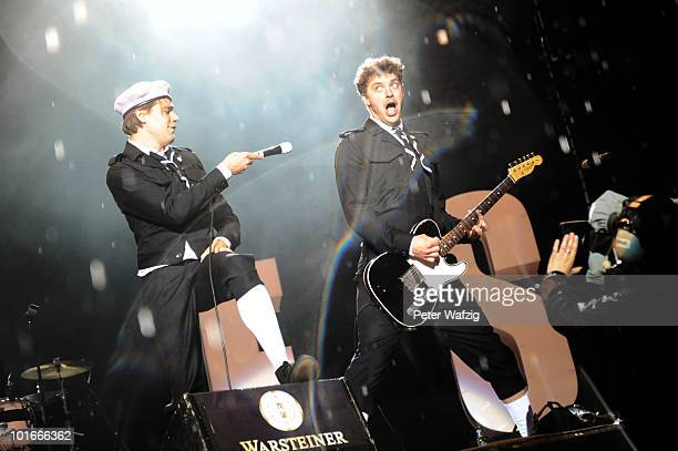 Per Almqvist and Nicholaus Arson of The Hives perform on stage during the fourth day of Rock am Ring on June 6, 2010 in Nuerburg, Germany.
