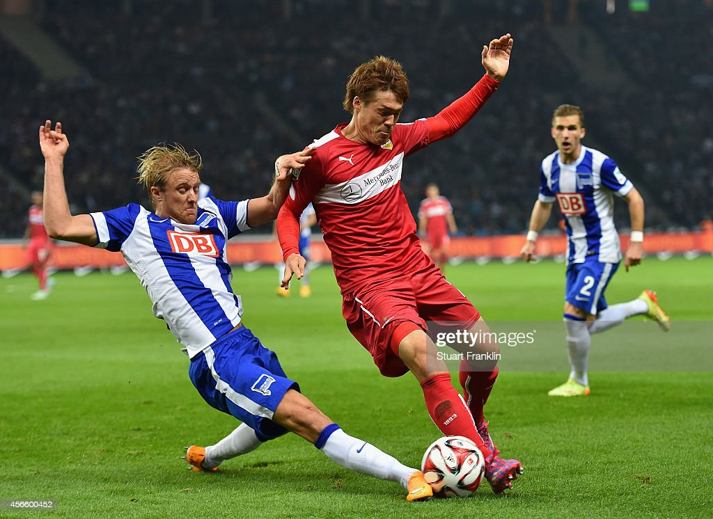 Per Ciljan Skjebred of Berlin is challenged by Gotoku Sakai of Stuttgart during the Bundesliga match between Hertha BSC and Vfb Stuttgart at Olympiastadion on October 3, 2014 in Berlin, Germany.