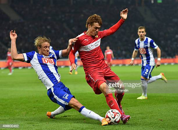 Per Ciljan Skjebred of Berlin is challenged by Gotoku Sakai of Stuttgart during the Bundesliga match between Hertha BSC and Vfb Stuttgart at...