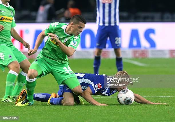 Per Ciljan Skjelbred of Berlin battles for the ball with Granit Xhaka of Moenchengladbach during the Bundesliga match between Hertha BSC and Borussia...