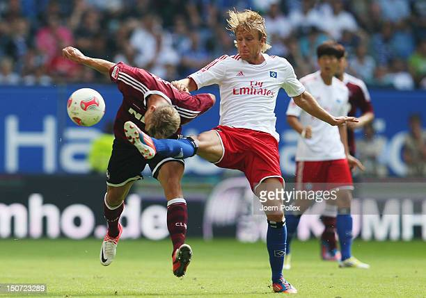 Per Ciljan Skjelbred of Hamburg and Mike Frantz of Nuernberg compete for the ball during the Bundesliga match between Hamburger SV and 1 FC Nuernberg...
