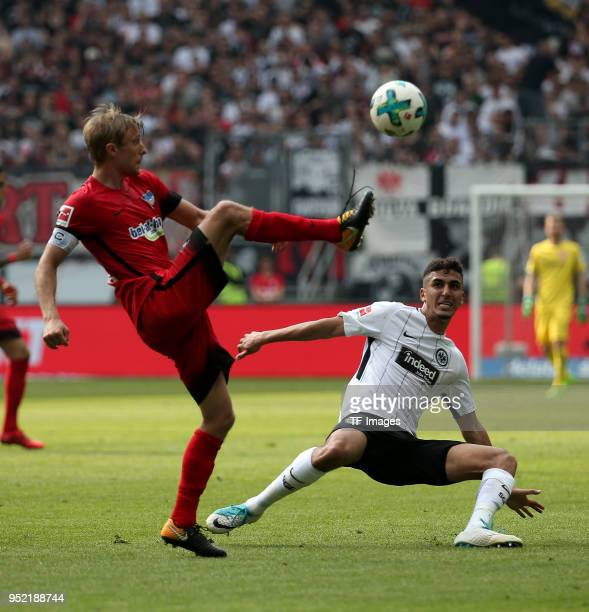 Per Ciljan Skjelbred of Hertha and Aymen Barkok of Frankfurt battle for the ball during the Bundesliga match between Eintracht Frankfurt and Hertha...