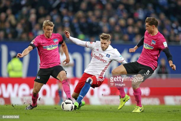 Per Ciljan Skjelbred of Hertha BSC Berlin and Aaron Hunt of Hamburg and Niklas Stark of Hertha BSC Berlin battle for the ball during the Bundesliga...