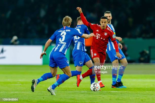 Per Ciljan Skjelbred of Hertha BSC Ondrej Duda of Hertha BSC Thiago Alcantara of FC Bayern Muenchen and Vedad Ibisevic of Hertha BSC battle for the...