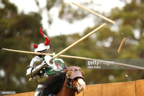 Per Estein ProisRohjell of Norway is hit as he competes in the inaugural World Jousting Championship against Cliff Marisma of Australia at the St...