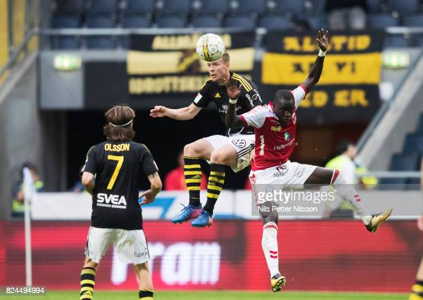 Per Karlsson of AIK and Papa Alioune Diouf of Kalmar FF competes for the ball during the Allsvenskan match between AIK and Kalmar FF at Friends arena...