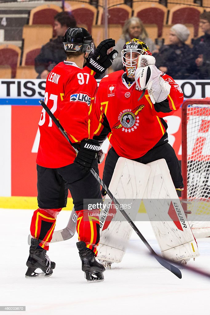 Per Ledin #97 of Lulea Hockey and Joel Lassinantti #34 Goaltender of Lulea Hockey celebrate after the game during the Champions Hockey League quarter final second leg game between Lulea Hockey and Lukko Rauma at Coop Norrbotten Arena on December 9, 2014 in Lulea, Sweden.