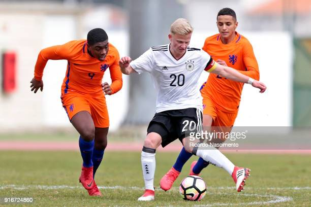 Per Locki of Germany U17 chalenges Toshio Lake of Netherlands U17 during U17Juniors Algarve Cup match between U17 Netherlands and U17 Germany at...