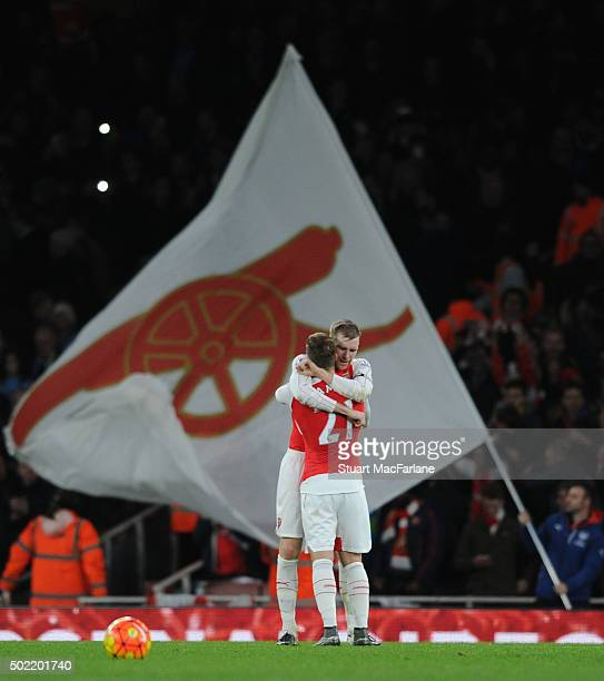 Per Mertesacker and Aaron Ramsey celebrate the Arsenal win after the Barclays Premier League match between Arsenal and Manchester City at Emirates...